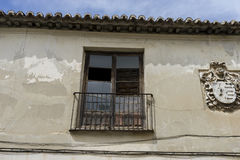Old iron window with wooden edges on a Spanish street. Tradition Royalty Free Stock Photos