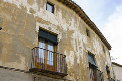Old iron window with wooden edges on a Spanish street. Tradition Stock Photo