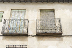 Old iron window with wooden edges on a Spanish street. Tradition Stock Image