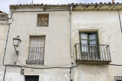 Old iron window with wooden edges on a Spanish street. Tradition Stock Images