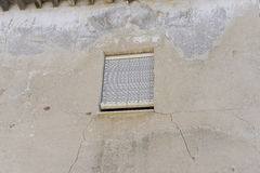 Old iron window with wooden edges on a Spanish street. Tradition Royalty Free Stock Image