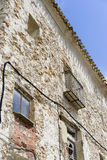 Old iron window with wooden edges on a Spanish street. Tradition Royalty Free Stock Photography