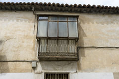 Old iron window with wooden edges on a Spanish street. Tradition Royalty Free Stock Images
