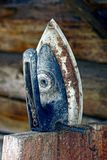 Old iron on a wooden stand in the dust Stock Images