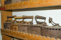 Old Irons put on the shelf Stock Photography