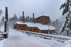 Old ironworks covered with snow in winter. Royalty Free Stock Photos