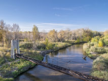 Old irrigation aqueduct acroos river Stock Photos