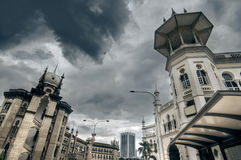 Old Islam style buildings. On street under dramatic sky in Kuala Lumpur, Malaysia, Asia Stock Photography
