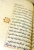 Islamic calligraphy book. A calligraphy hand written antique holy koran book of Islam religion, opened and taken at close up to show the beauty of the arabian royalty free stock image