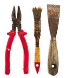 Old isolated tools:putty knife, pliers, brush Royalty Free Stock Photos