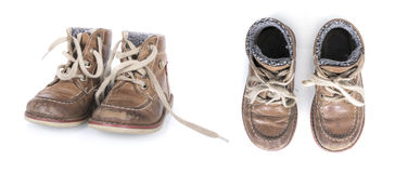 Old isolated worn boy shoes Stock Images