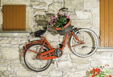 Old Italian bicycle. Red old Italian bicycle on sunlight. Ancient buildings Royalty Free Stock Photography