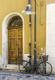 Old Italian bicycle. On sunlight. Ancient buildings Stock Image