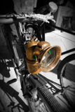 Old Italian Bike. Detail of an old Italian bicycle, in black and white and colors, with headlight and dynamo Royalty Free Stock Photography