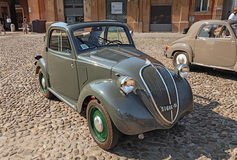 Old italian car Fiat 500 B Topolino (1949). Old italian small car Fiat 500 B Topolino Trasformabile (1949) parked during the classic car, motorcycle and bicycle Stock Image