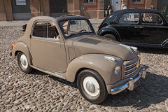 Old italian car Fiat 500 C Topolino (1954). Old italian small car Fiat 500 C Topolino Trasformabile (1954) parked during the classic car, motorcycle and bicycle Stock Photo