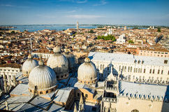 Old Italian cathedral aerial view. Amazing aerial view of the city of Venice. Old cathedral in the foreground Stock Photo