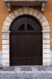 Old Italian door. Stock Photo