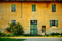 Old Italian house. Exterior details of colorful old Italian house with shuttered windows royalty free stock images