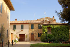 Old italian house a sunny summer day in the town of Montalcino, Royalty Free Stock Photos