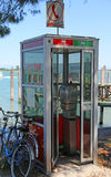 Old Italian phone booth out of order Royalty Free Stock Images