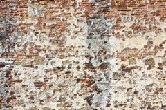 Old italian stone and brick wall with degraded plaster.  royalty free stock images