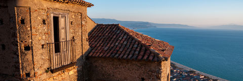Old Italian stone house over small town by the sea Royalty Free Stock Photo