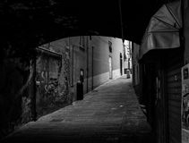 Old Italian streets arch, walls and windows black and white phot. O in Genoa, Italy Stock Photos