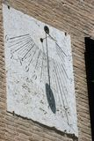 Old italian sundial in stone support Stock Photography