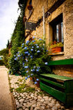 Old italian village building with flowers Stock Image