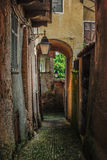 Old italian village. Road with arcade in the italian alps medieval ancient village Stock Photography