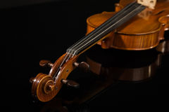 Old  italian violin over black Stock Photos