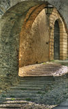 Old italy: through a archway. Looking light and shadows between an archway in northwest italy Stock Photos