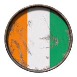 Old Ivory Coast flag. 3d rendering of an Ivory Coast flag over a rusty metallic plate. Isolated on white background Royalty Free Stock Images