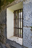 Old jail barred windows at angle Stock Photos