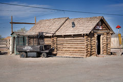 Old Jail and Carriage Beside. One of the remarkable places of the Route 66- old antique jail with the carriage on the side, laying on the road of the Route 66 Royalty Free Stock Images