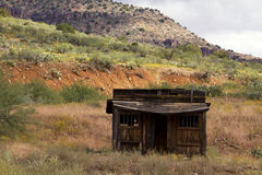 Old jail in the moutains of eastern Arizona. Old wood jail house in the brilliant yellow and gold colored fall foliage in the Tonto National Forest mountains of Royalty Free Stock Photo