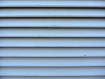 Old jalousie window with wooden slats gray painted texture Stock Photos
