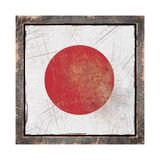 Old Japan flag. 3d rendering of a Japan flag over a rusty metallic plate wit a rusty frame. Isolated on white background Stock Image