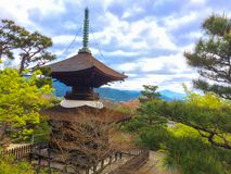 Japanese pagoda on the mountain in the temple with the sky full of clouds background royalty free stock photos
