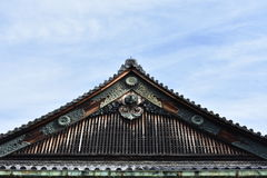 Old Japanese castle roof. Under blue sky Stock Image