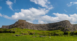 Old Japanese castle wall. On green grass and blue sky with cloud at Okinawa Japan stock photos