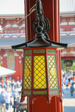 An Old Japanese Lamp. An old colorful Japanese lamp hanging on a pole at Asakusa Shrine royalty free stock images