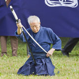 Old Japanese man playing martial arts in traditional customes Stock Photo