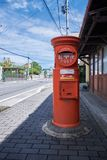 Matsumoto, Nagano Prefecture, Japan 08.26.2017: Old Japanese Post Pillar-box. An Old Japanese Post Pillar box standing on pedestrian way near a traditional Royalty Free Stock Photo