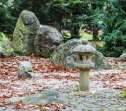 Old Japanese stone lantern. Covered with moss Royalty Free Stock Photos