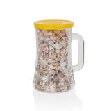 Old jar filled with small seashells Royalty Free Stock Images