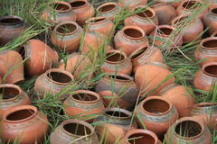Old jars lying on the grass. Decorative clay vase in garden stock photography