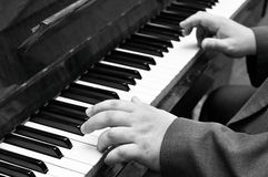 Old jazz musician plays piano.  Royalty Free Stock Image
