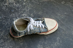 Old jean sneaker Royalty Free Stock Photo